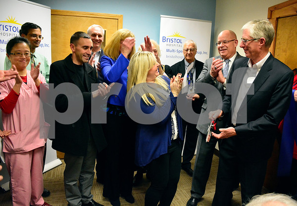 2/8/2018 Mike Orazzi   Staff The Greater Southington Chamber of Commerce Executive Director Taylor Crofton, Bristol Hospital President and CEO Kurt Barwis and Bristol Hospital Chairman of the Board Douglas Devnew cut a ribbon at the multi-specialty group's new Southington office at 98 Main Street Thursday evening.