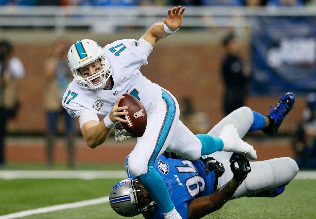 . Miami Dolphins quarterback Ryan Tannehill (17) is sacked by Detroit Lions defensive end Ezekiel Ansah (94) during the first half of an NFL football game in Detroit, Sunday, Nov. 9, 2014. (AP Photo/Rick Osentoski)