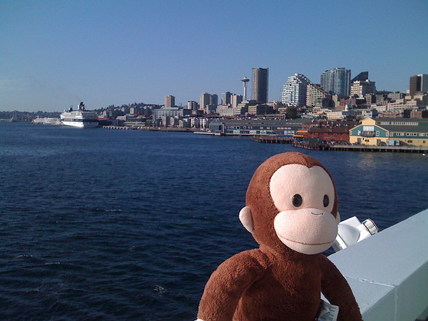 curious george with the Seattle skyline